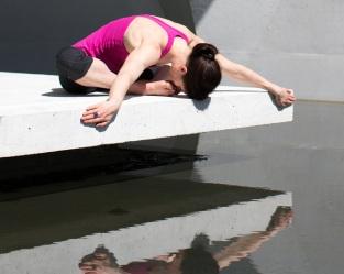 yoga pose forward fold over water 8x10